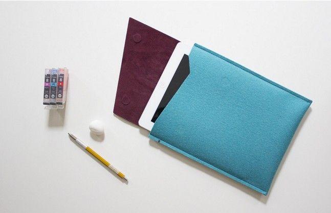 Deok加上了磁鐵開闔袋口設計的Jun多功能平板電腦保護套,美麗的配色十分引人注目