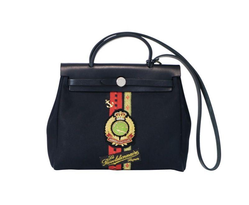 Dylan Ryu黑色織帶徽章手提包,NT115,080