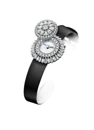 海瑞溫斯頓ROSEBUD頂級珠寶腕錶18K白金材質,錶盤選用白色珍珠母貝製作