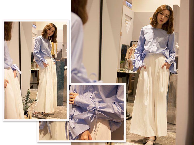 【LOOK 5】柔和派好感色系必備單品:造型襯衫+及地寬版褲在春夏最受歡迎的水藍、白、粉等清新明亮的色系,是提升好感度的最佳選擇!如何為平凡造型中加入鮮明的個人印象,可選擇在上衣下襬或袖口處有獨特設計的款式,像是1/2 UN-DEMI運用繫繩綁帶束口的寬袖襯衫,搭配上SKETCHAROUND顯瘦的寬版裙褲,讓低調優雅的魅力在不誇張的設計巧思中一一展現。