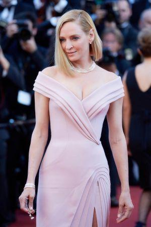 鄔瑪舒曼配戴BVLGARI Serpenti 頂級玫瑰金鑽石項鍊與手環出席第70屆坎城影展開幕紅毯