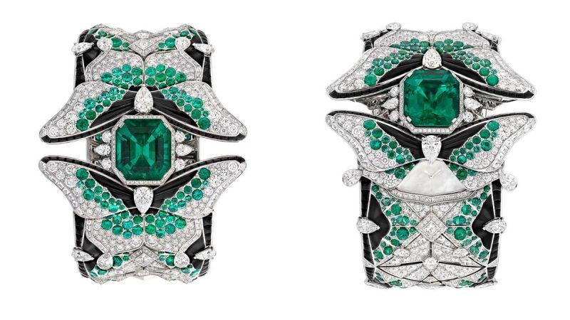 PAPILLON SECRET 腕錶白K金、鑽石、祖母綠、黑色尖晶石、縞瑪瑙、白色珍珠貝母、一顆14.57克拉祖母綠切割祖母綠(哥倫比亞)、手動上鏈機械機芯。以指尖移動蝴蝶的後翅,即顯露隱藏其後的珍珠貝母錶盤。讓佩戴者在祖母綠、黑色尖晶石及鑽石的簇擁下窺視時間。