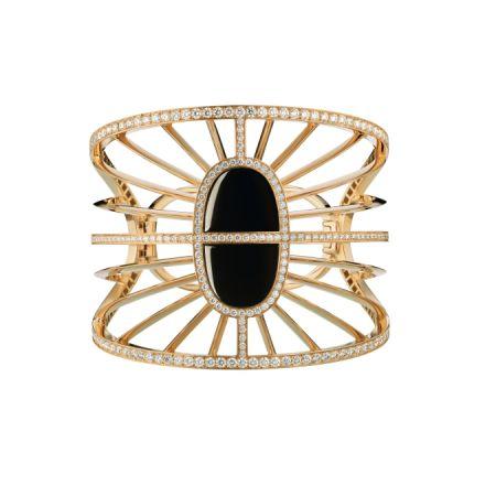 黃金鑲白鑽與黑玉手環,Hermès,NT786,700。