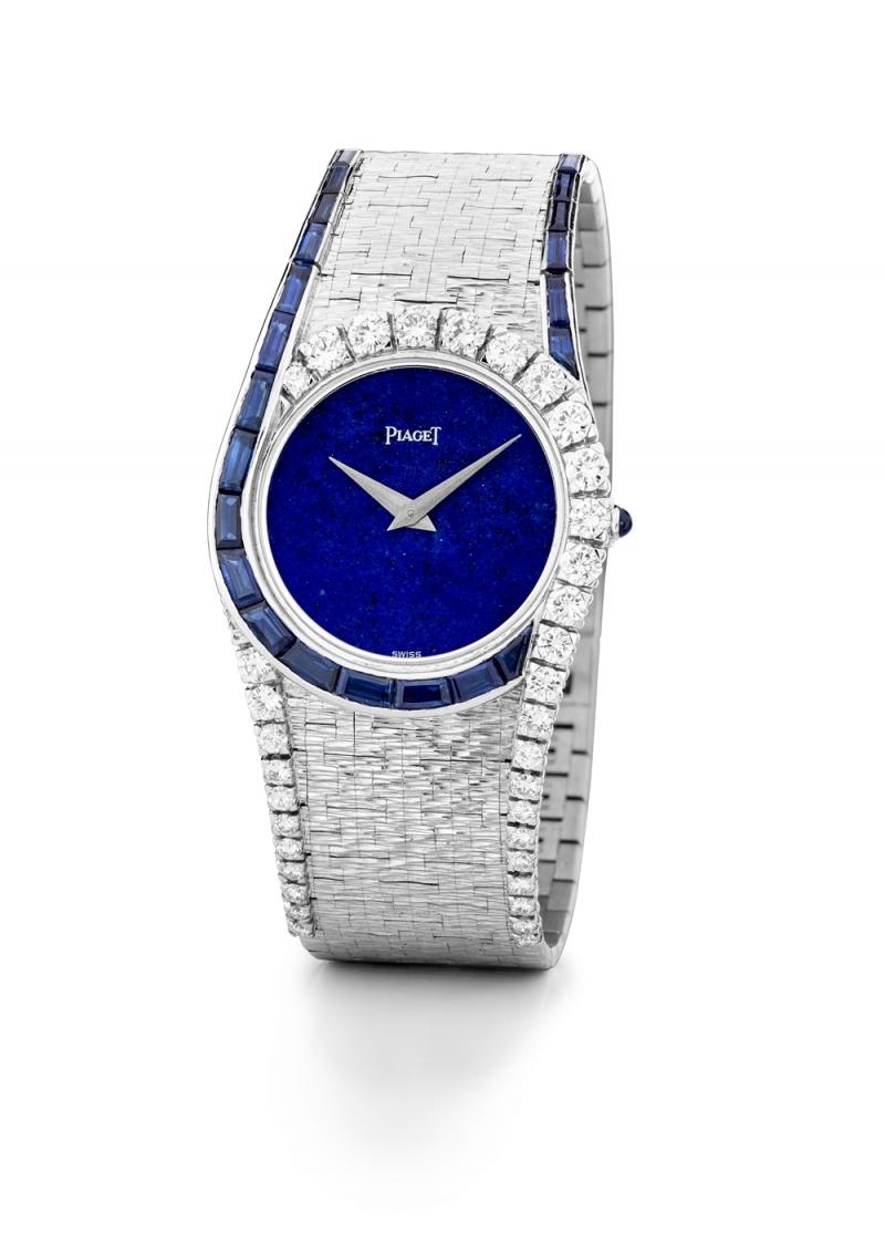 伯爵古董珠寶腕錶 18K白金 錶殼鑲嵌35顆明亮型切割鑽石 (約1.6克拉)及22顆狹長方型切割藍寶石 (約2.54克拉) 搭載伯爵傳奇9P超薄手動上錬機械機芯 1971年 伯爵傳承典藏 9188 A6