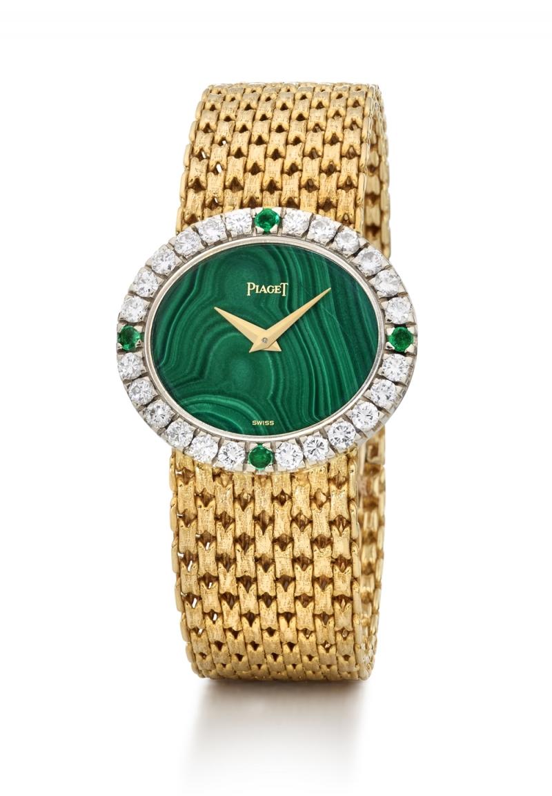 寶石錶盤腕錶 伯爵古董珠寶腕錶黃金材質 孔雀石錶盤 錶殼鑲嵌24顆明亮型切割鑽石 (約1.3克拉) 及4顆祖母綠寶石 (約0.16 克拉) 搭載伯爵傳奇9P超薄手動上錬機械機芯 1968年 伯爵傳承典藏 9804 N24