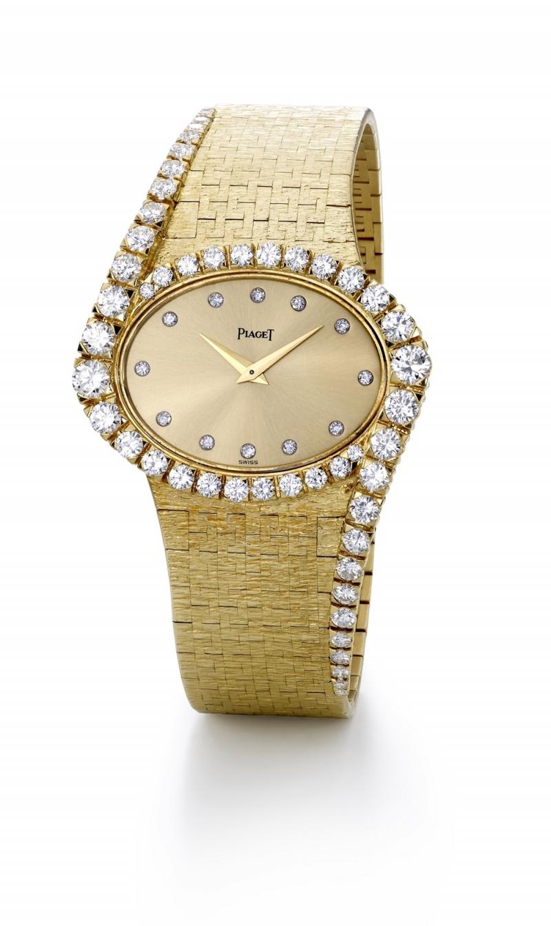 伯爵古董珠寶腕錶黃金材質 金色錶盤搭配鑽石時標 鑲嵌50顆明亮型切割鑽石(約3.6克拉) 搭載伯爵傳奇9P超薄手動上錬機械機芯 1977年 伯爵傳承典藏 9857 A6